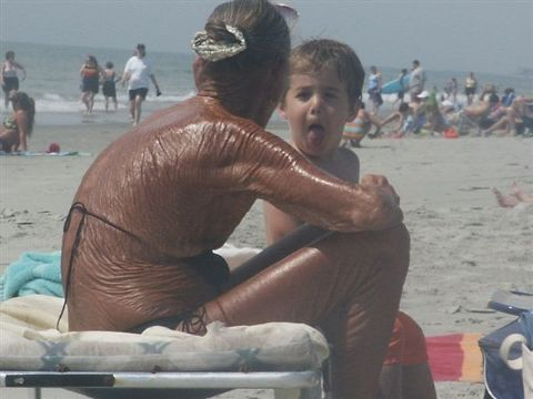 We should take this horrible looking lady's as the ideal example of sunscreen usage...